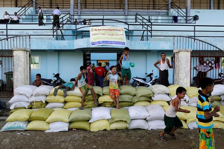 Rakhine Buddhists who fled from recent violence in Maungdaw pass their time in a temporary shelter at a stadium in Sittwe, Myanmar, Octobe