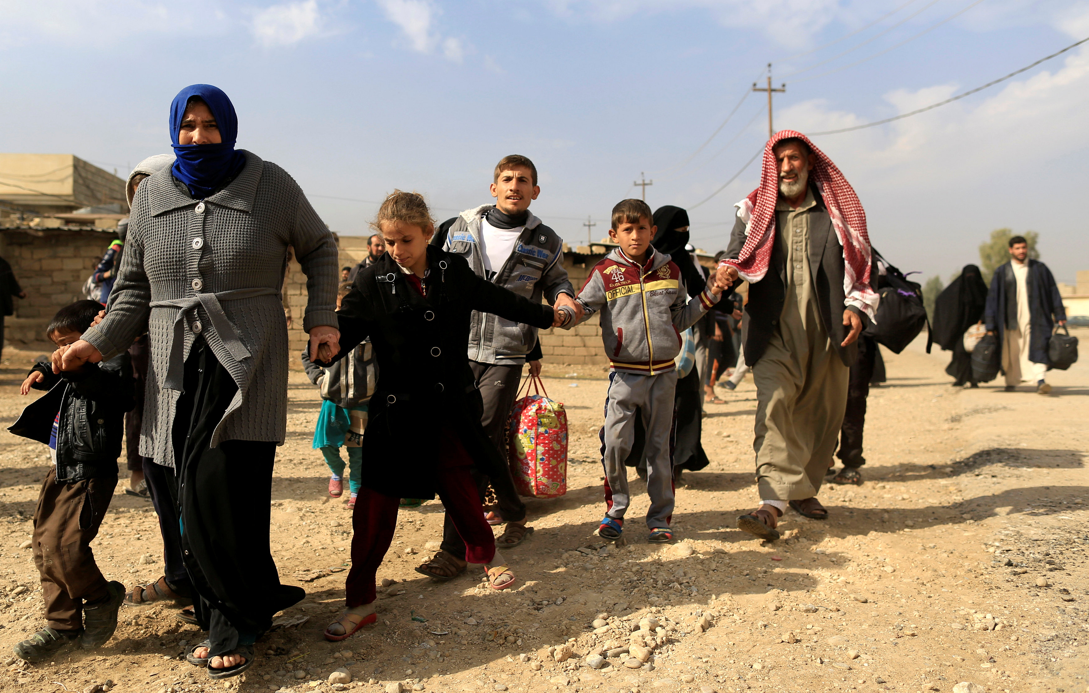 A family fleeing fighting between the Islamic State and Iraqi army in Intisar disrict of eastern Mosul, make their way to safer territory, Iraq