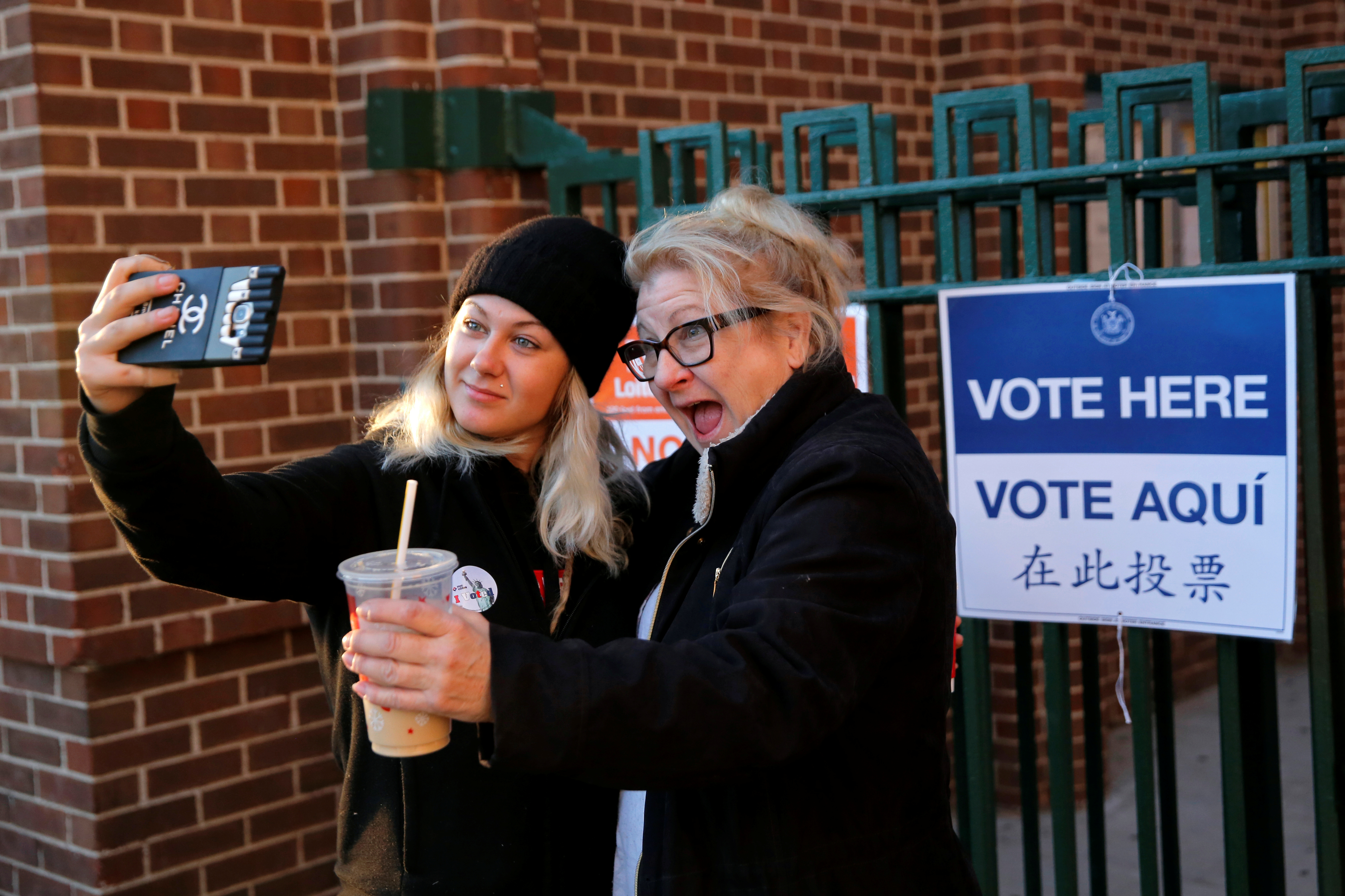 First-time voter Kaeli Askea poses for a selfie with her mother Erin Collins-Askea after voting at the James Weldon Johnson school in East Harlem, New York City.