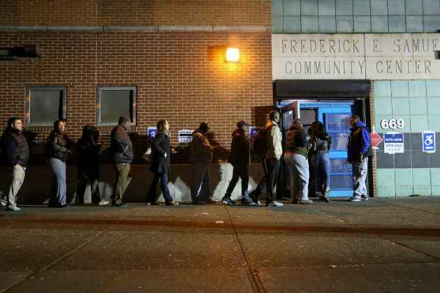 Voters line up to cast their ballot on election day at a polling station in Harlem.