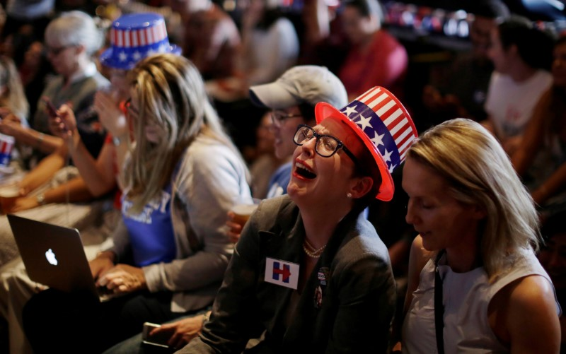 Supporters of Hillary Clinton react as a state is called in favor of Donald Trump during a watch party at the University of Sydney in Australia.