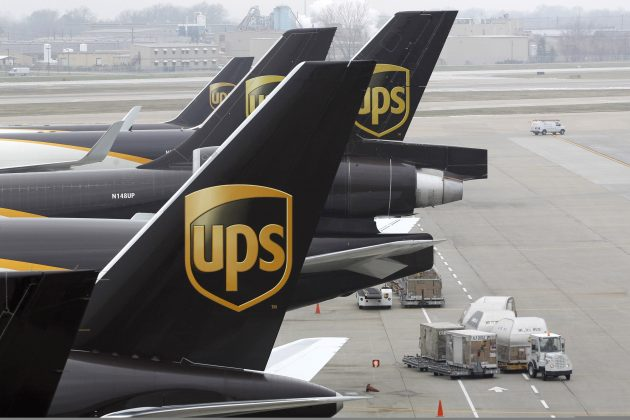 United Parcel Service aircraft are loaded with package containers at the UPS Worldport All Points International Hub in Louisville, Kentucky,