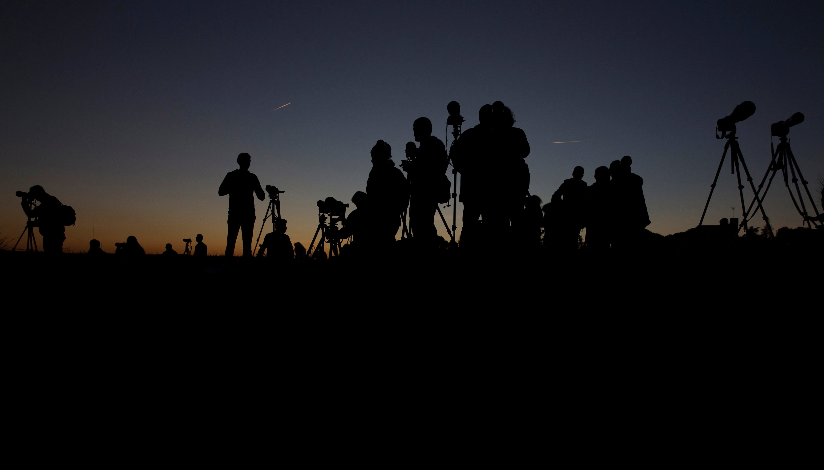 People set up their cameras as they wait for the supermoon in Madrid, Spain