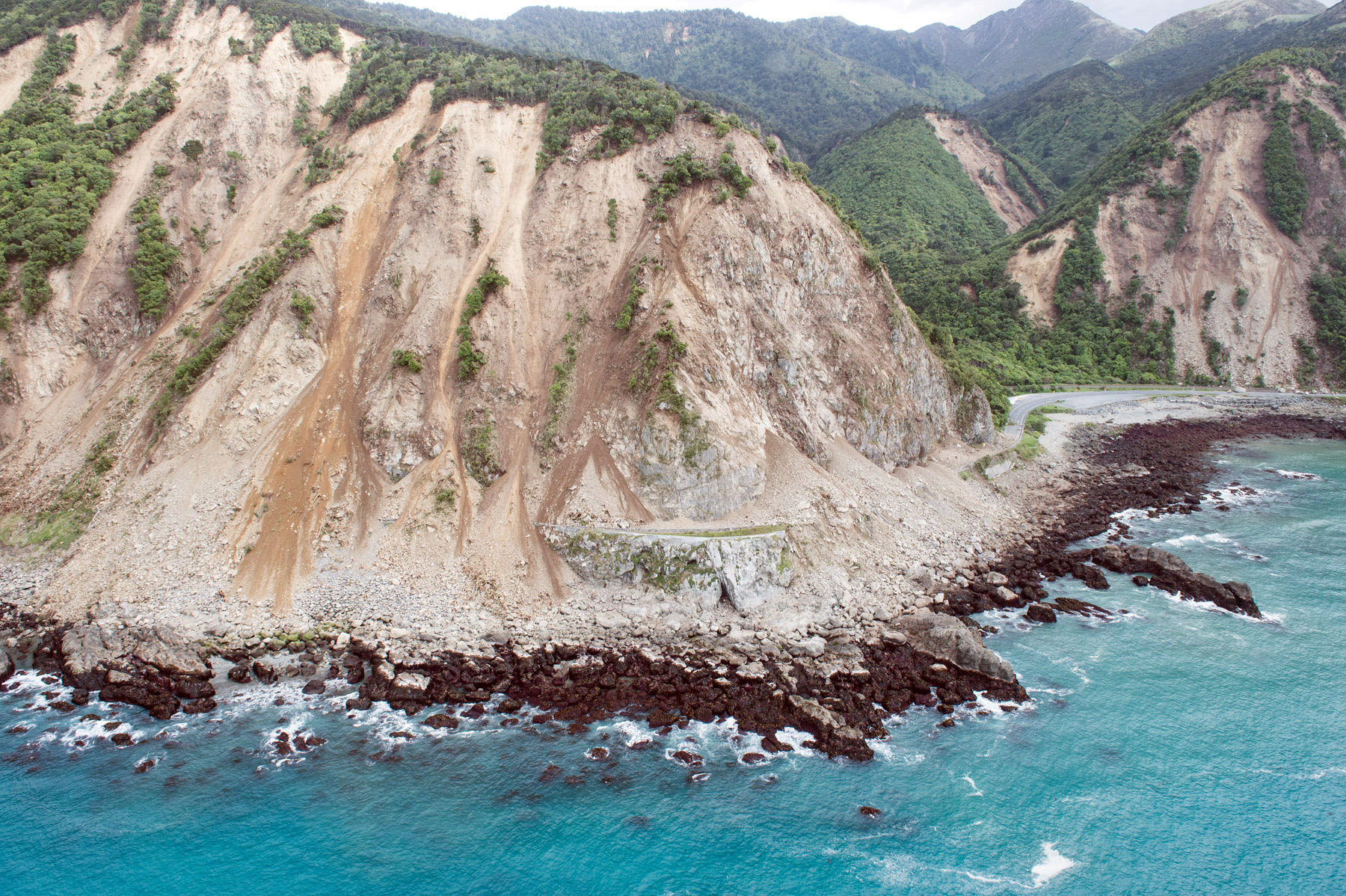 Landslides block State Highway One near Kaikoura on the upper east coast of New Zealand's South Island following an earthquake, November 14, 2016. Sgt Sam Shepherd/Courtesy of Royal New Zealand