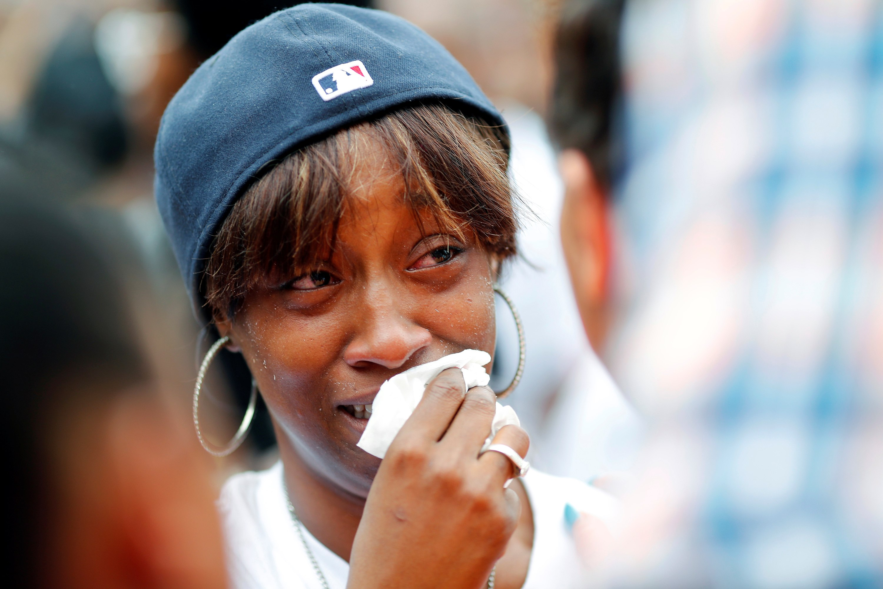 Diamond Reynolds, girlfriend of Philando Castile, weeps as people gather to protest the fatal shooting of Castile by Minneapolis area police during a traffic stop on Wednesday, in St. Paul, Minnesota, U.S.,