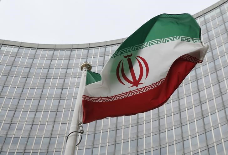 An Iranian flag flutters in front of the International Atomic Energy Agency (IAEA) headquarters in Vienna, Austria,