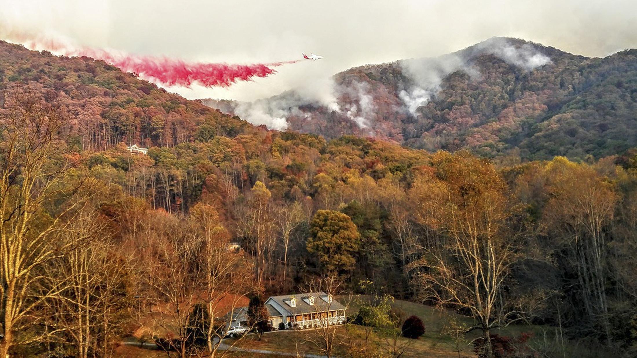 A heavy air tanker drops fire retardant over the Boteler wildfire near Hayesville, North Carolina, U.S.