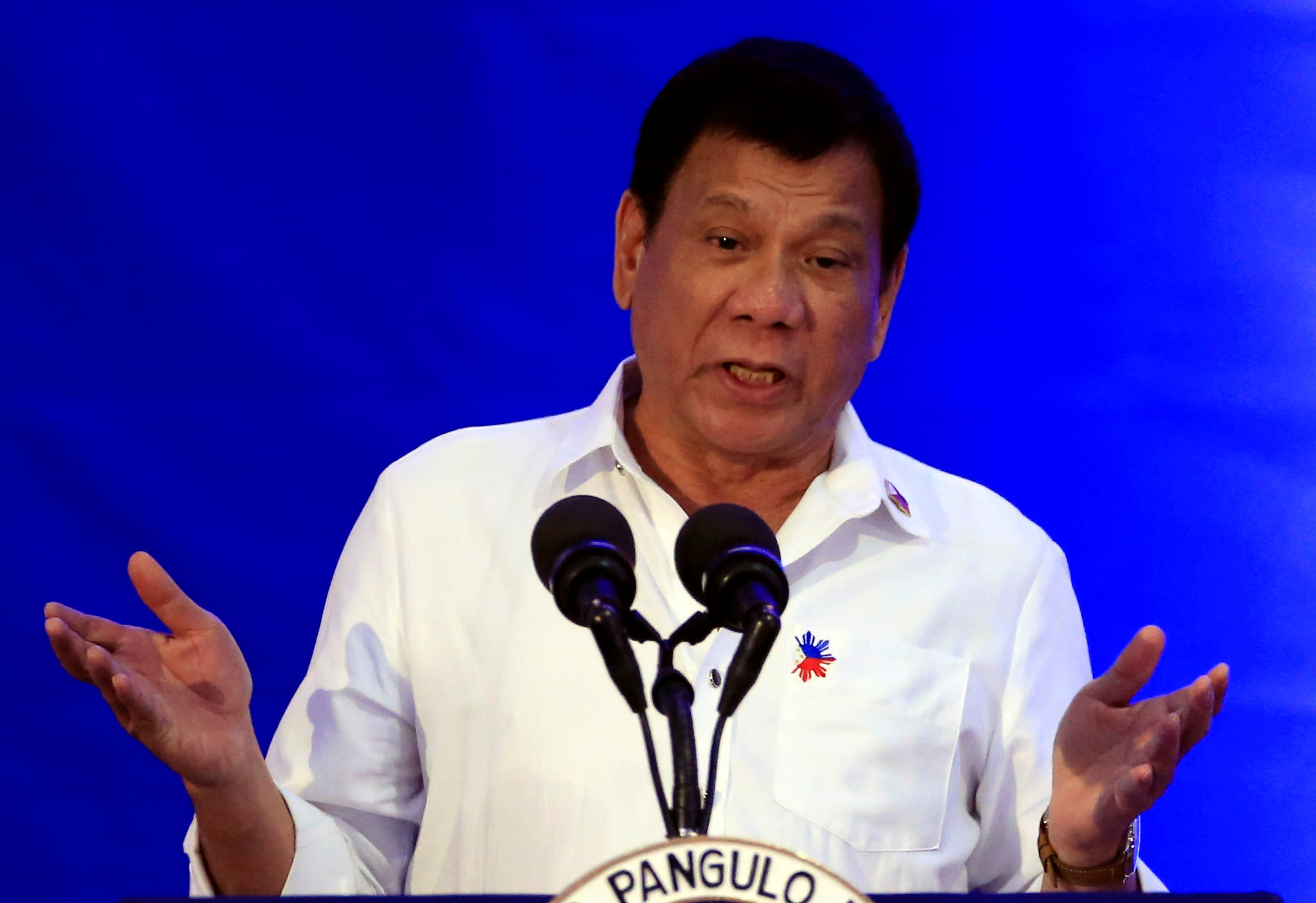 Philippine President Rodrigo Duterte gestures while delivering a speech during the 80th National Bureau of Investigation (NBI) founding anniversary at the NBI headquarters in metro Ma