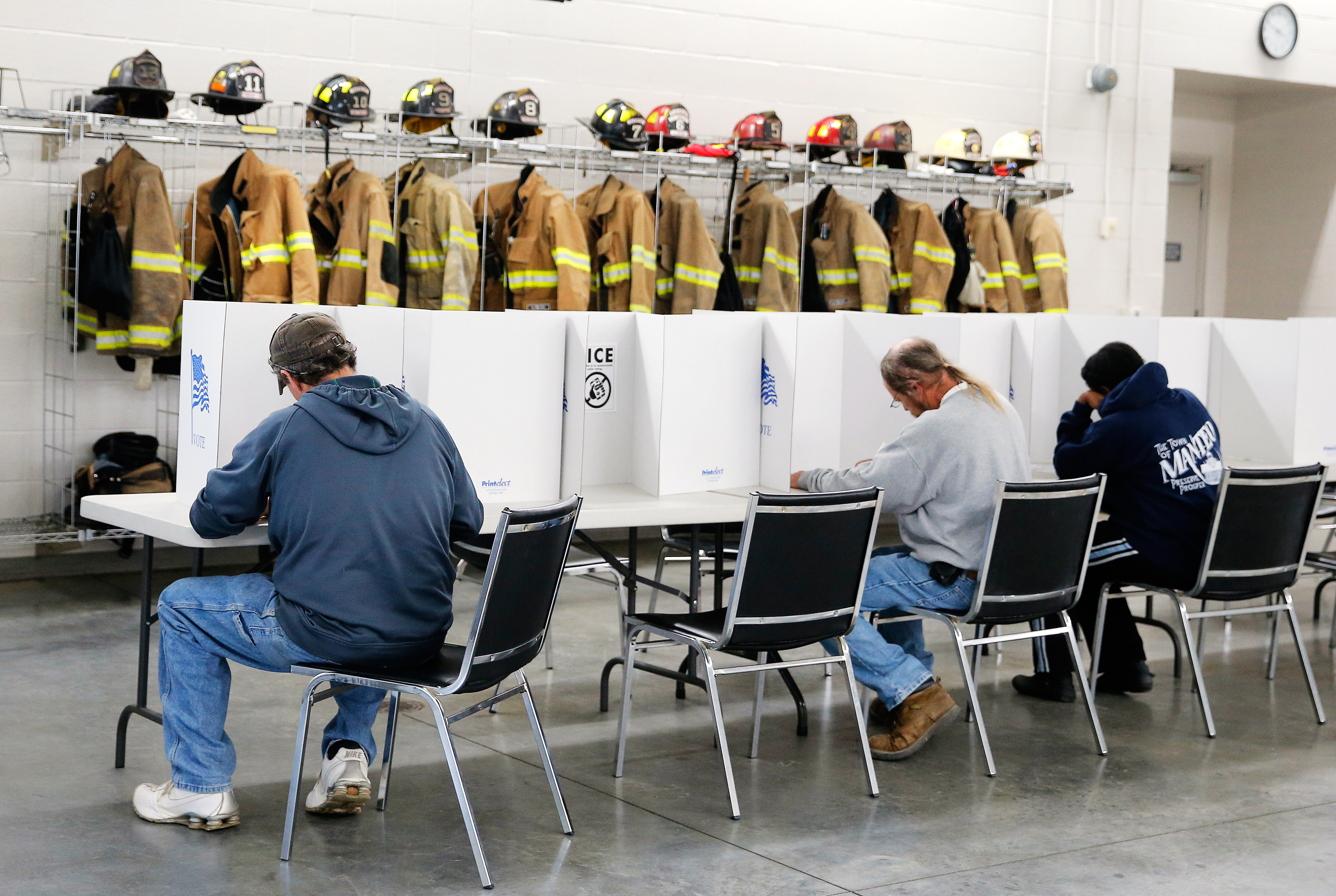 Voters fill out their ballots on election day for the U.S. presidential election at Elevation Fire Station in Benson, North Carolina