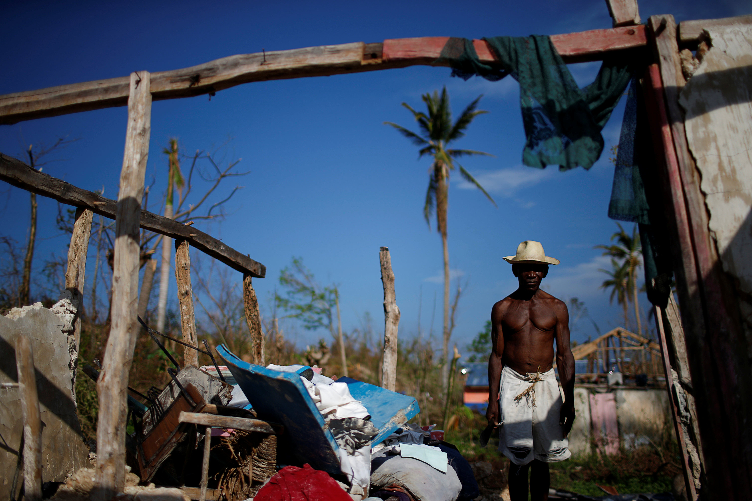 "Liface Luc, 66, poses for a photograph in his destroyed house after Hurricane Matthew hit Jeremie, Haiti, October 15, 2016. ""I don't need to say nothing, my house explains everything. It's completely flat. I lost everything; my crops, my animals, so I have nothing left. It's like my two hands had been cut. What can I say? I'm at death's door,"" said Luc."