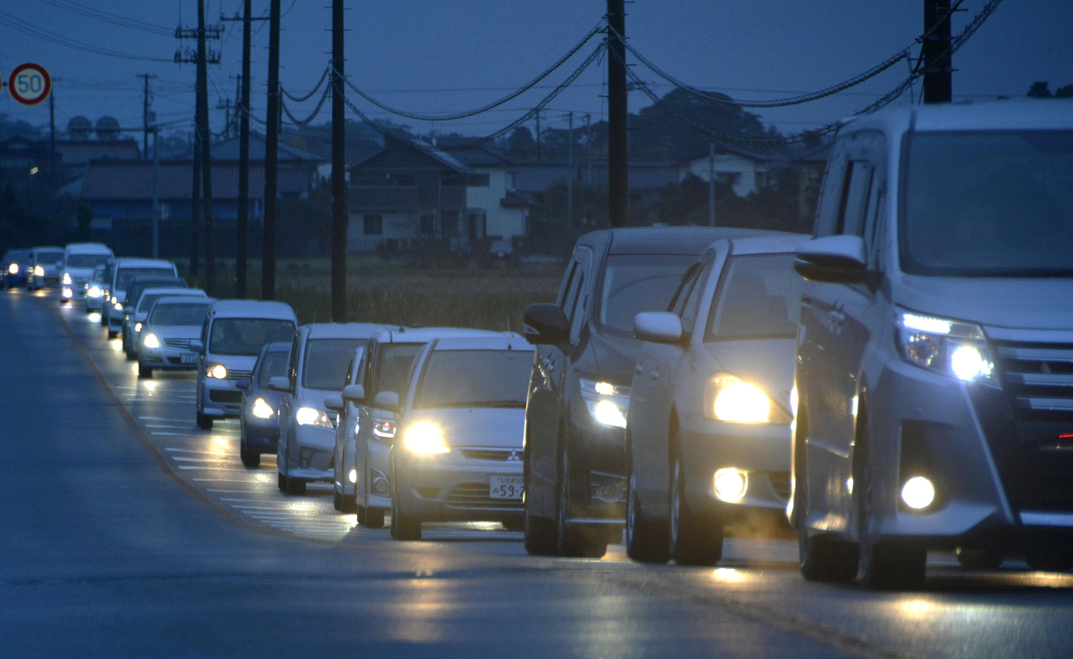A traffic jam is seen as people evacuate after tsunami advisories were issued following an earthquake, in Iwaki, Fukushima prefecture, Japan, in this photo taken by Kyodo November 22, 2016. Kyodo/via