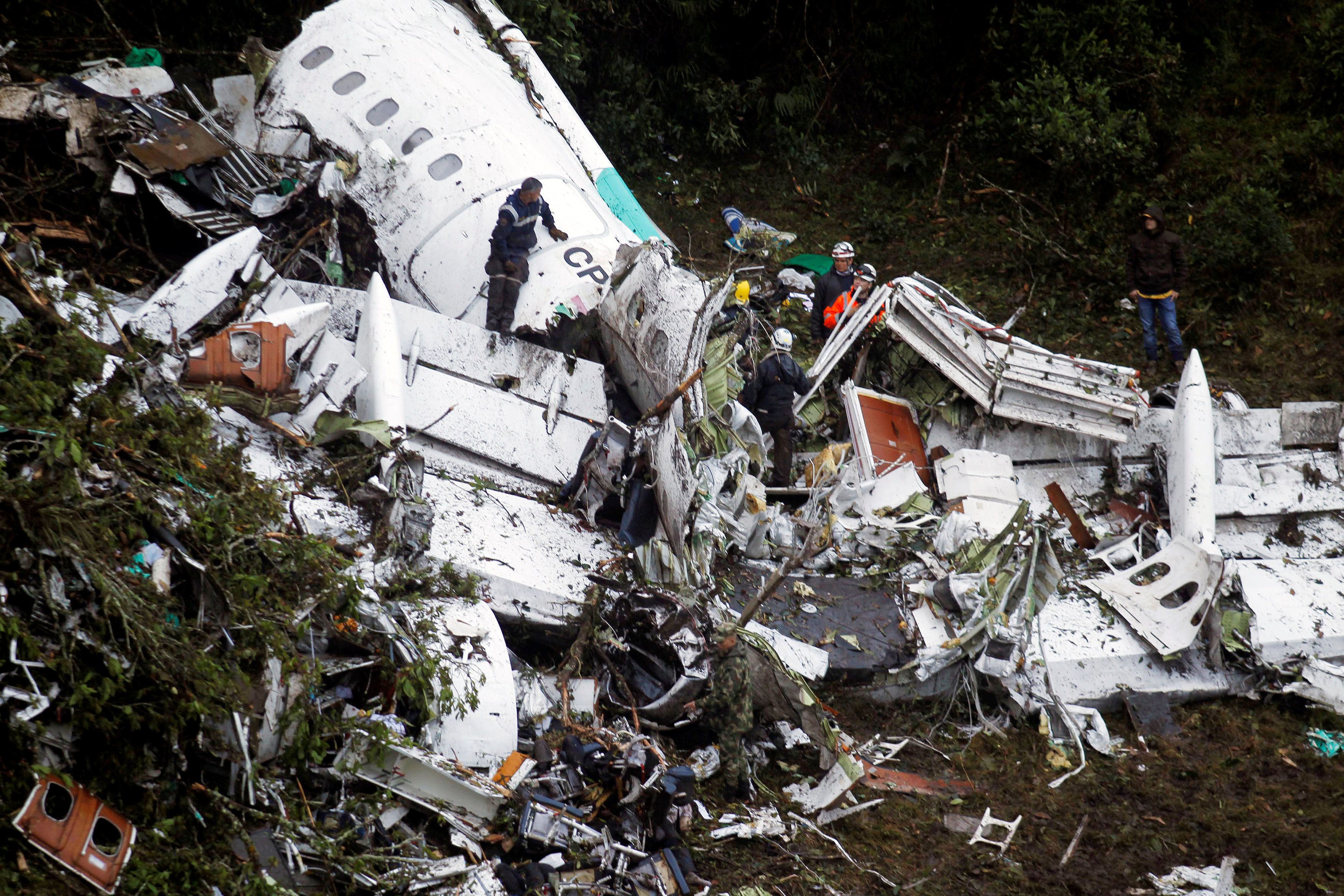 Rescue crew work in the wreckage from a plane that crashed into Colombian jungle with Brazilian soccer team Chapecoense near Medellin, Colombia,