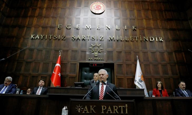 Turkey's Prime Minister Binali Yildirim addresses members of parliament from his ruling AK Party (AKP) during a meeting at the Turkish parliament in Ankara, Turkey,