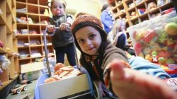 Children receive toys at a refugee shelter run by German charity organisation Arbeiter Samariter Bund ASB in Berlin, Germany,