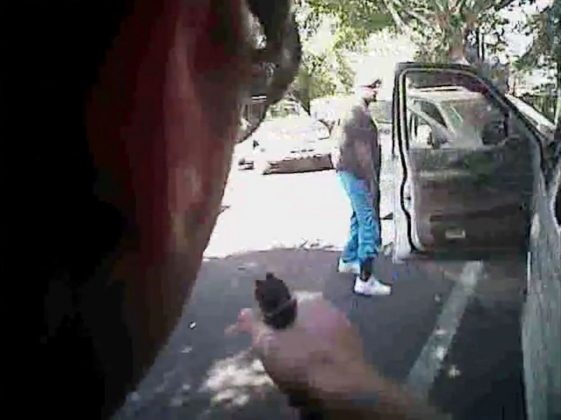 Keith Scott looks over to police with hands by his sides just before he was shot four times by Charlotte police in Charlotte, North Carolina,