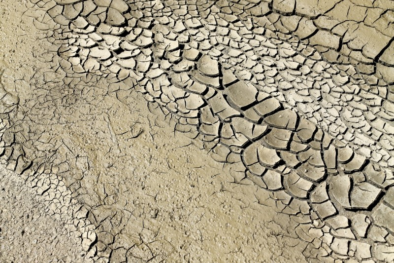 Mud cracks along a dried riverbed are pictured near San Ysidro, California