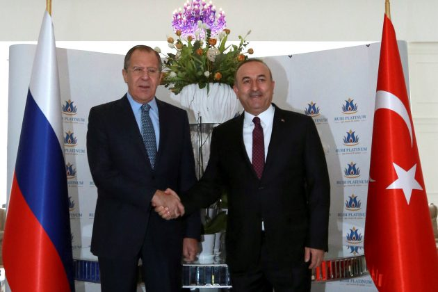 Russian Foreign Minister Sergei Lavrov shakes hands with his Turkish counterpart Mevlut Cavusoglu in Alanya, Turkey,