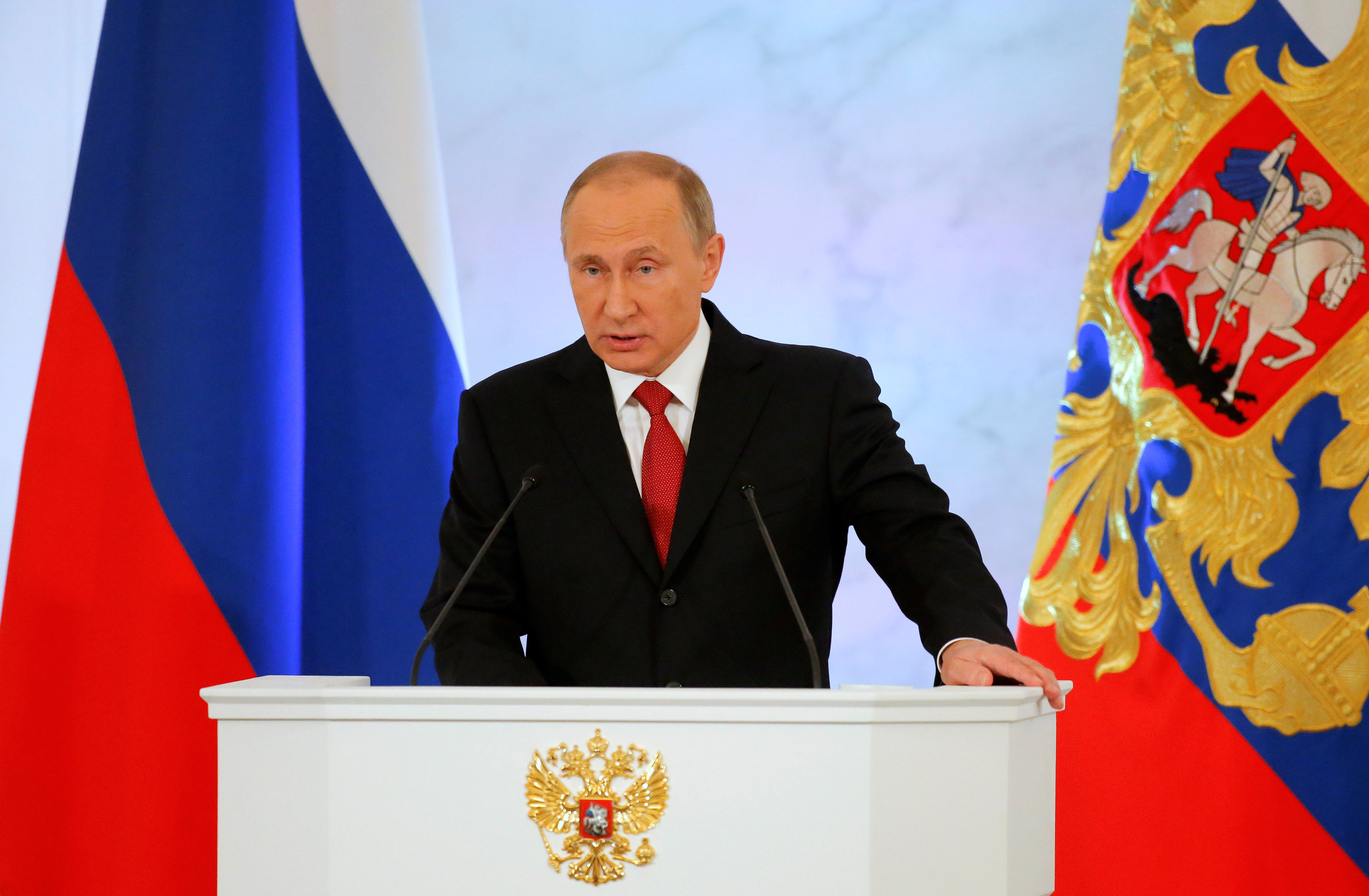 Russian President Vladimir Putin delivers a speech during his annual state of the nation address at the Kremlin in Moscow, Russia,