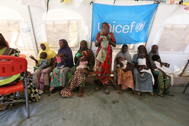 Nigerian Women and Children waiting at a nutrition clinic