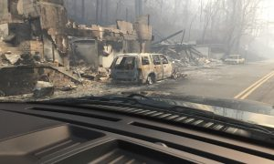 Burned buildings and cars aftermath of wildfire is seen in this image released in social media by Tennessee Highway Patrol in Gatlinburg, Tennessee,