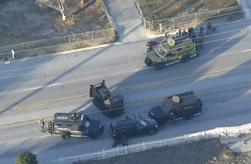 An SUV with its windows shot out that police suspect was the getaway vehicle from at the scene of a shooting in San Bernardino, California is shown in this aerial photo December 2, 2015.