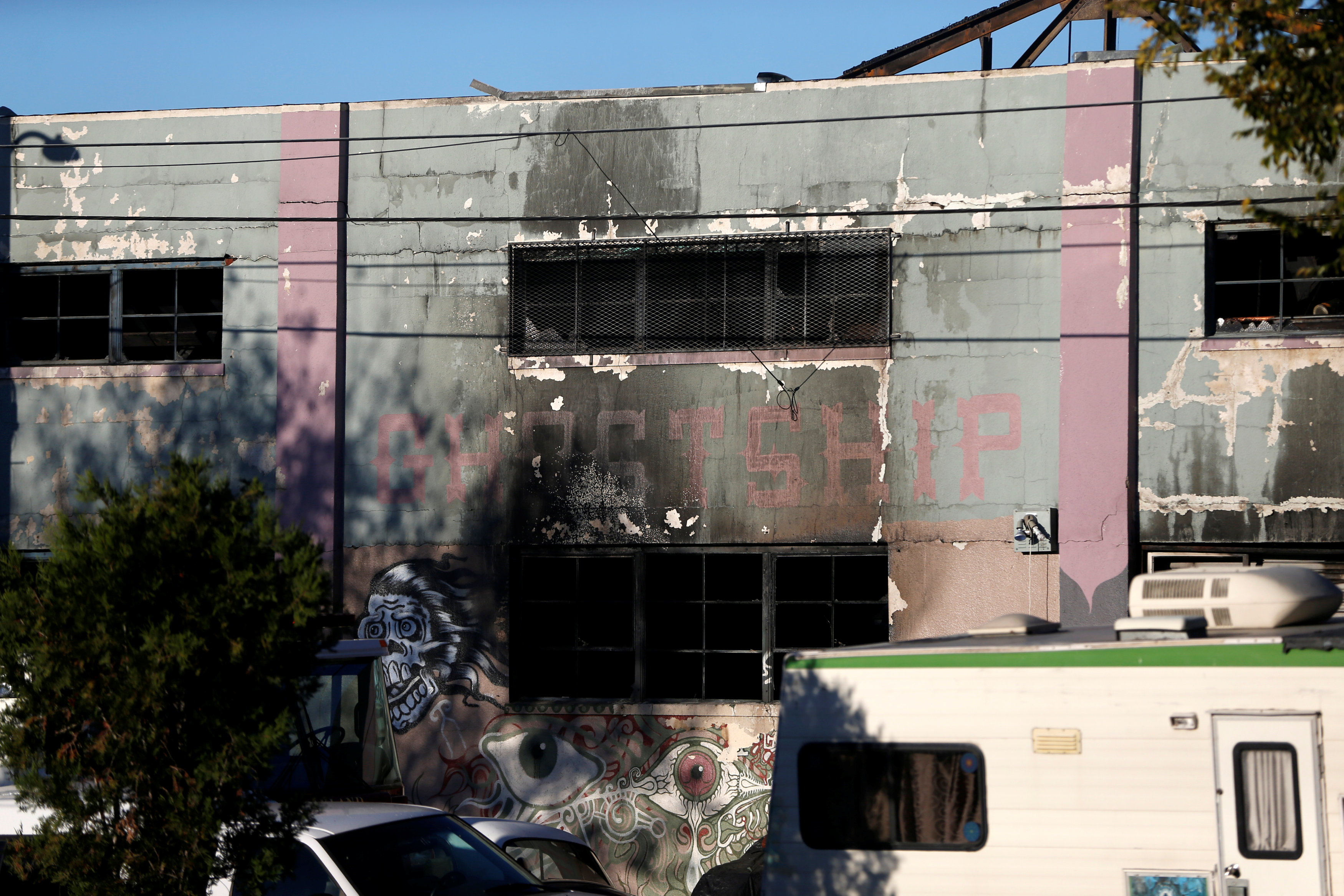 A charred wall is seen outside a warehouse after a fire broke out during an electronic dance party late Friday evening, resulting in at least nine deaths and many unaccounted for in the Fruitvale district of Oakland, California, U.S.