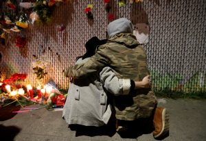 Two friends embrace at memorial for California warehouse victims