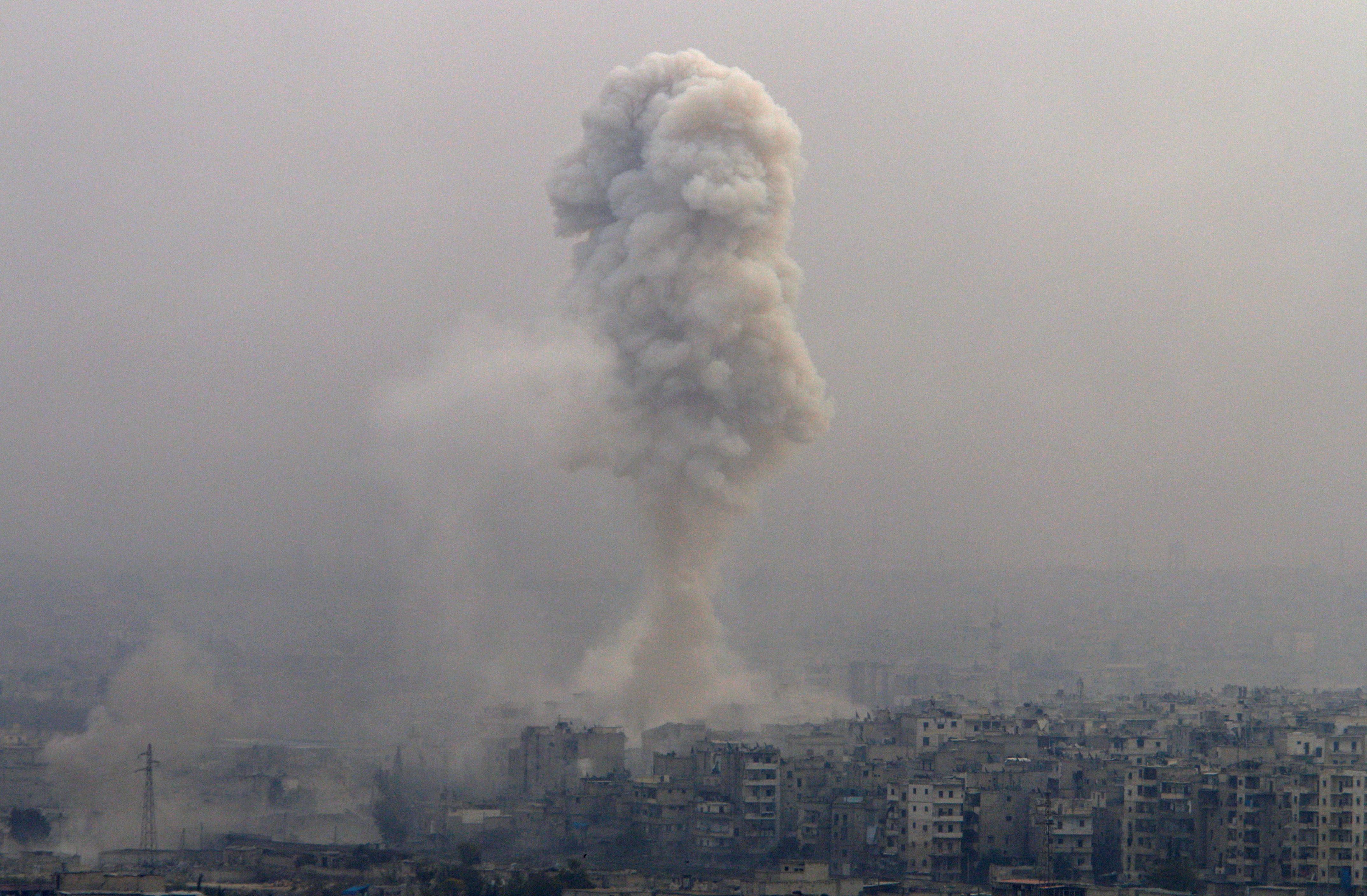 smoke rises after air strike