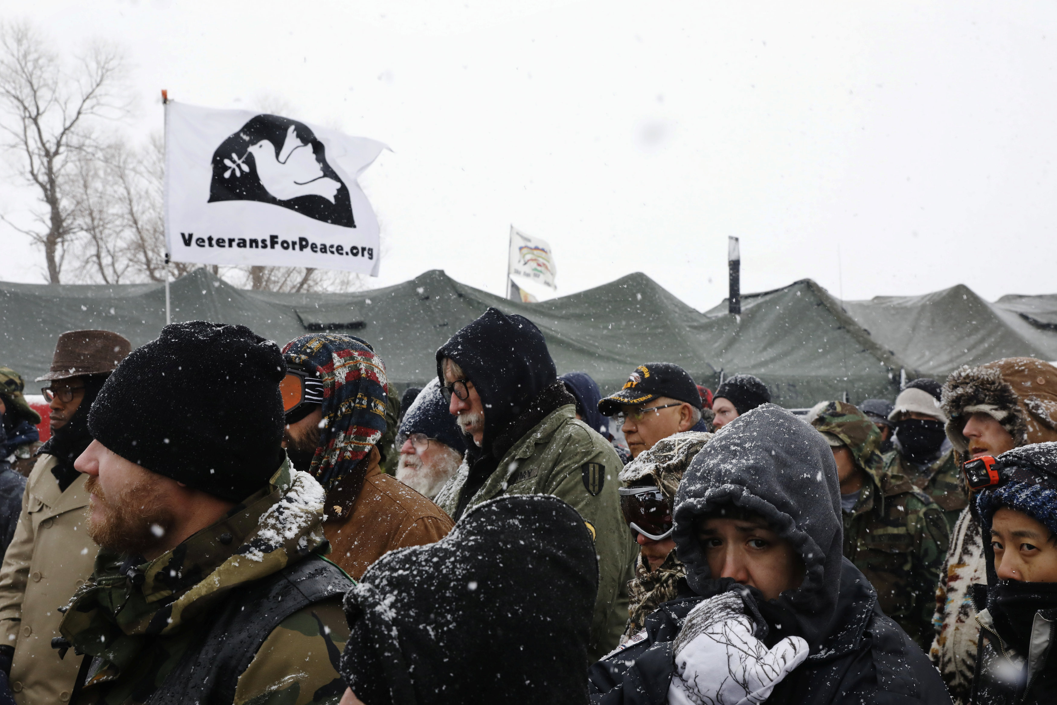 "Veterans gather for a briefing inside of the Oceti Sakowin camp during a snow fall as ""water protectors"" continue to demonstrate against plans to pass the Dakota Access pipeline adjacent to the Standing Rock Indian Reservation, near Cannon Ball, North Dakota"