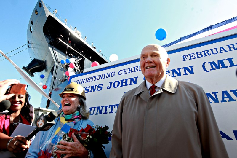 Senator John Glenn speaks with reporters, with his Daughter Lyn Glenn, during the christening ceremony for the USNS John Glenn at the General Dynamics NASSCO Shipyard in San Diego, California