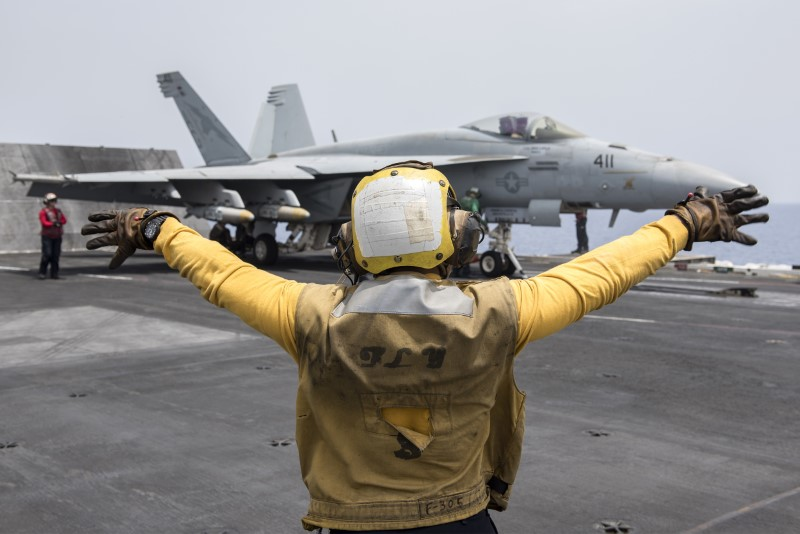 A U.S. Navy crewman directs an F/A-18E Super Hornet fighter jet on the flight deck of the aircraft carrier USS Harry S. Truman in the Mediterranean Sea in a photo released by the US Navy June 3, 2016. U U.S. Navy/Mass Communication Specialist 3rd Class