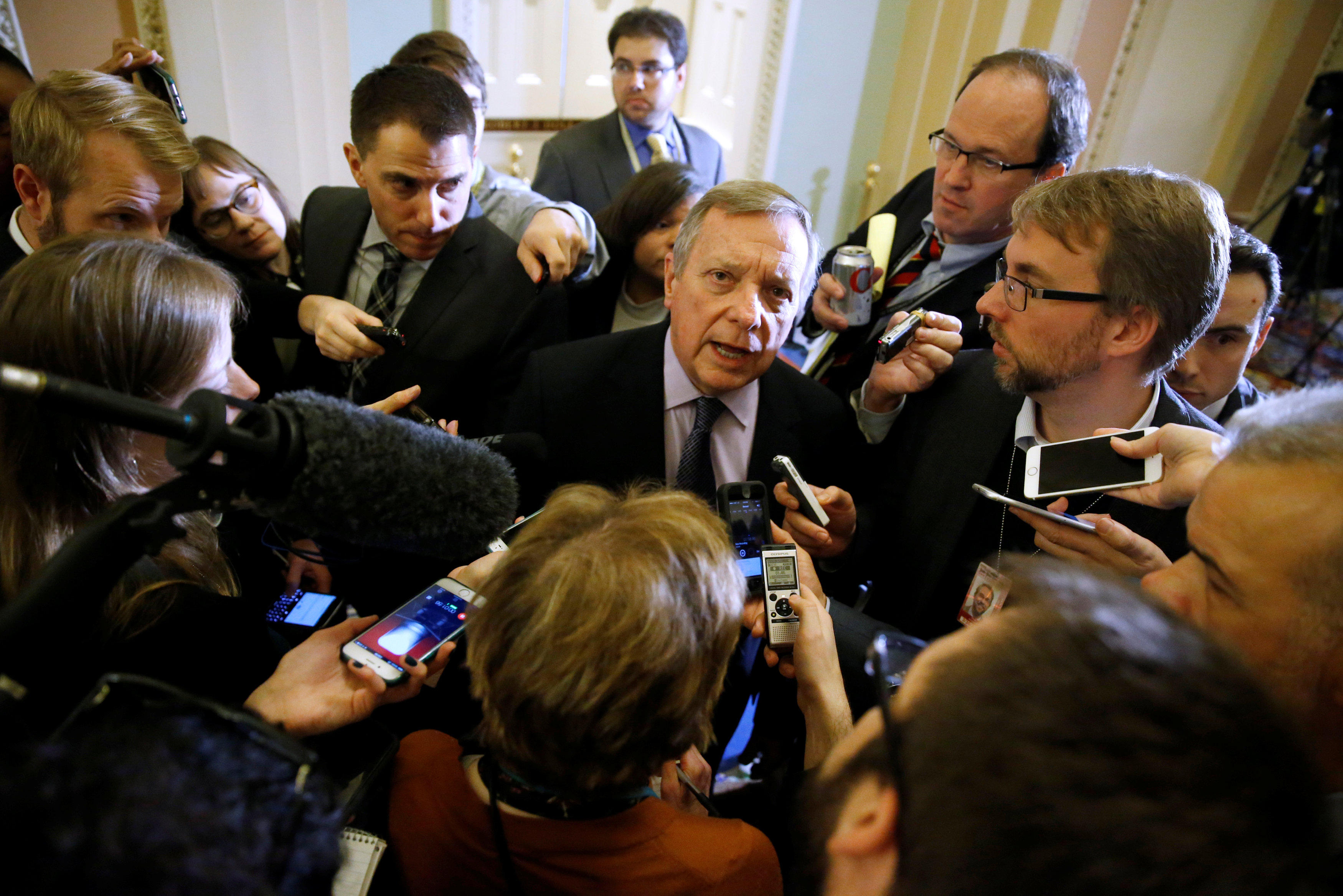 U.S. Senator Richard Durbin (D-IL) (C) talks with reporters after the weekly Democratic caucus policy luncheon at the U.S. Capitol in Washington, U.S.