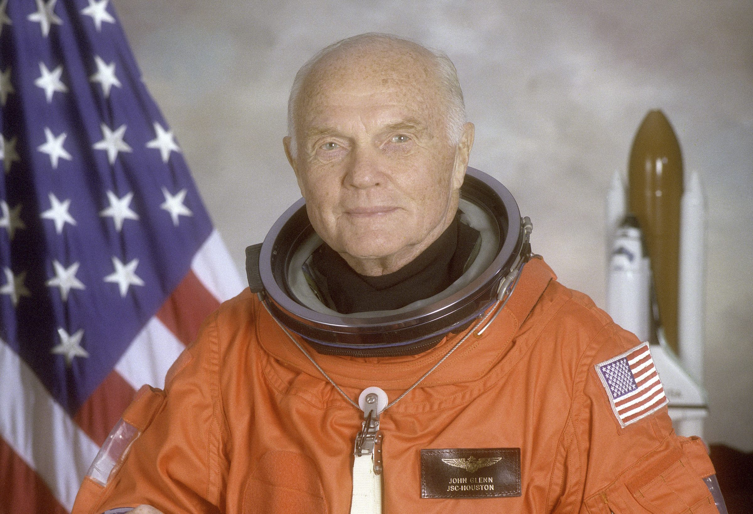 STS-95 crewmember, astronaut and U.S. Senator John Glenn poses for his official NASA photo taken April 14, 1998.