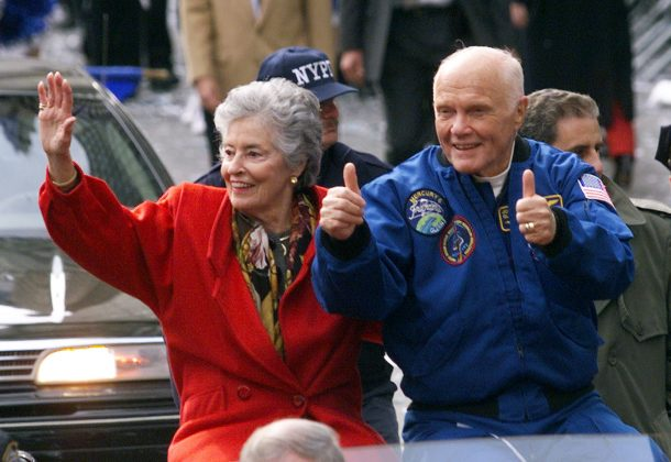 """Astronaut John Glenn gives the thumbs up as he rides in an open car with his wife Annie during a ticker tape parade down New York's """"Canyon of Heroes"""" on lower Broadway in New York, U.S"""