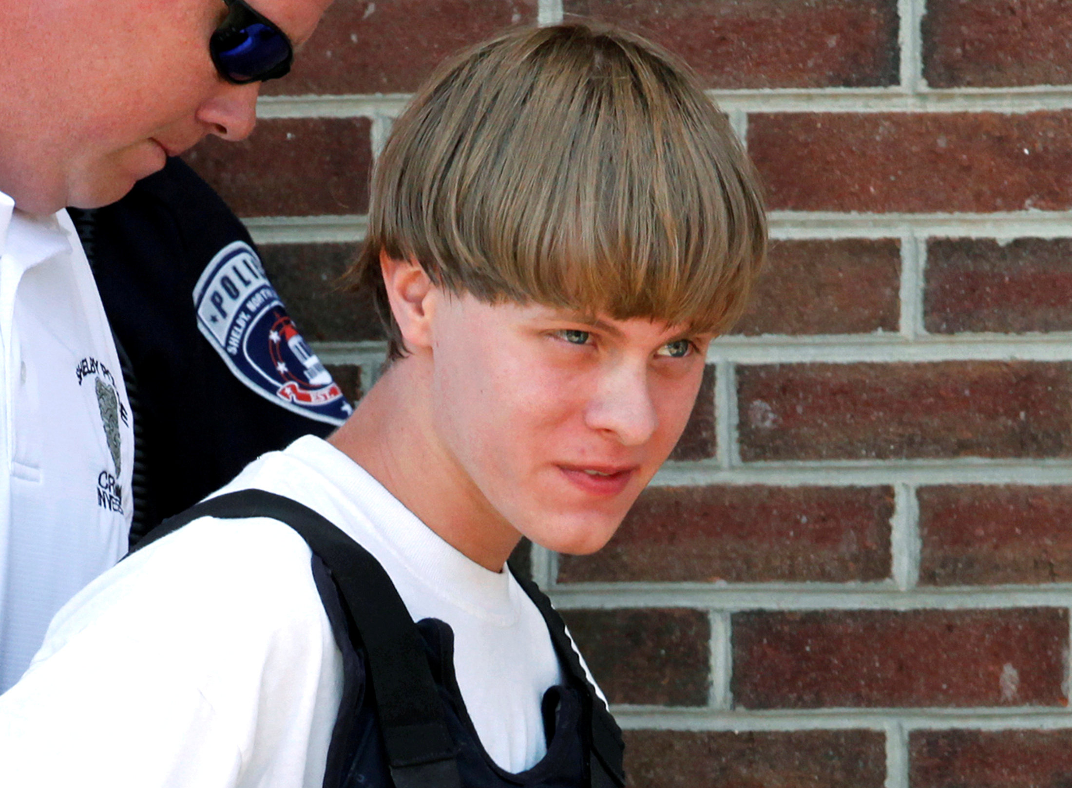 Police lead suspected shooter Dylann Roof into the courthouse in Shelby, North Carolina,