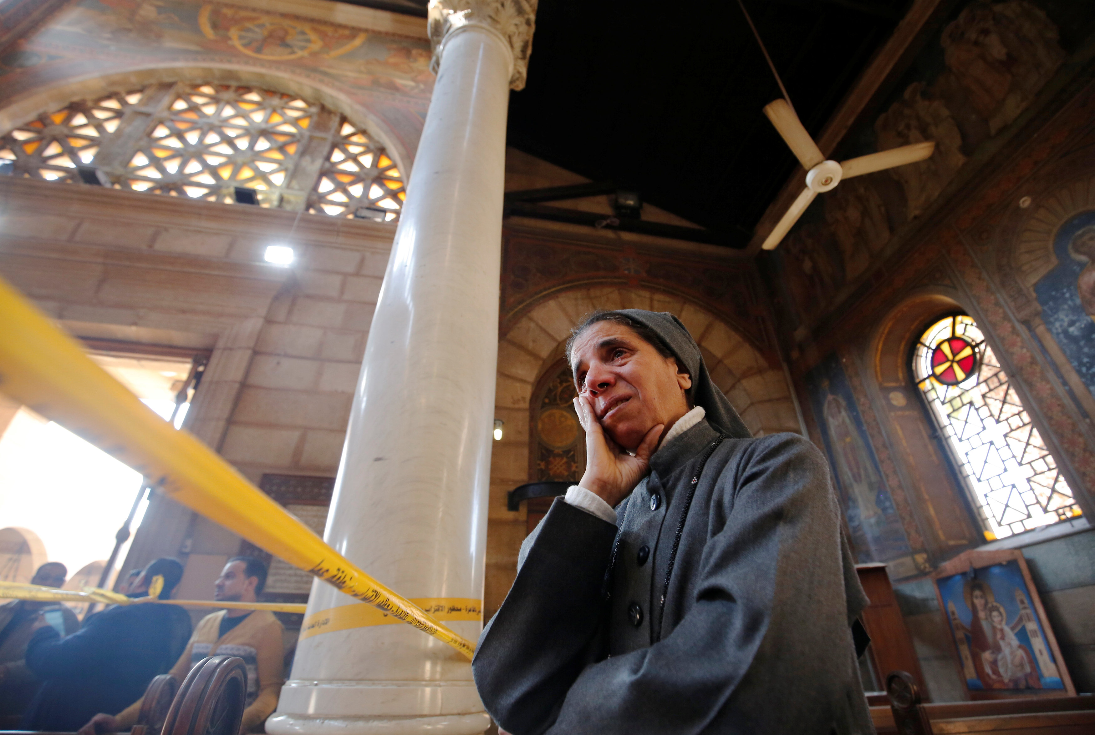 A nun cries at the scene of the Cairo Church bombing
