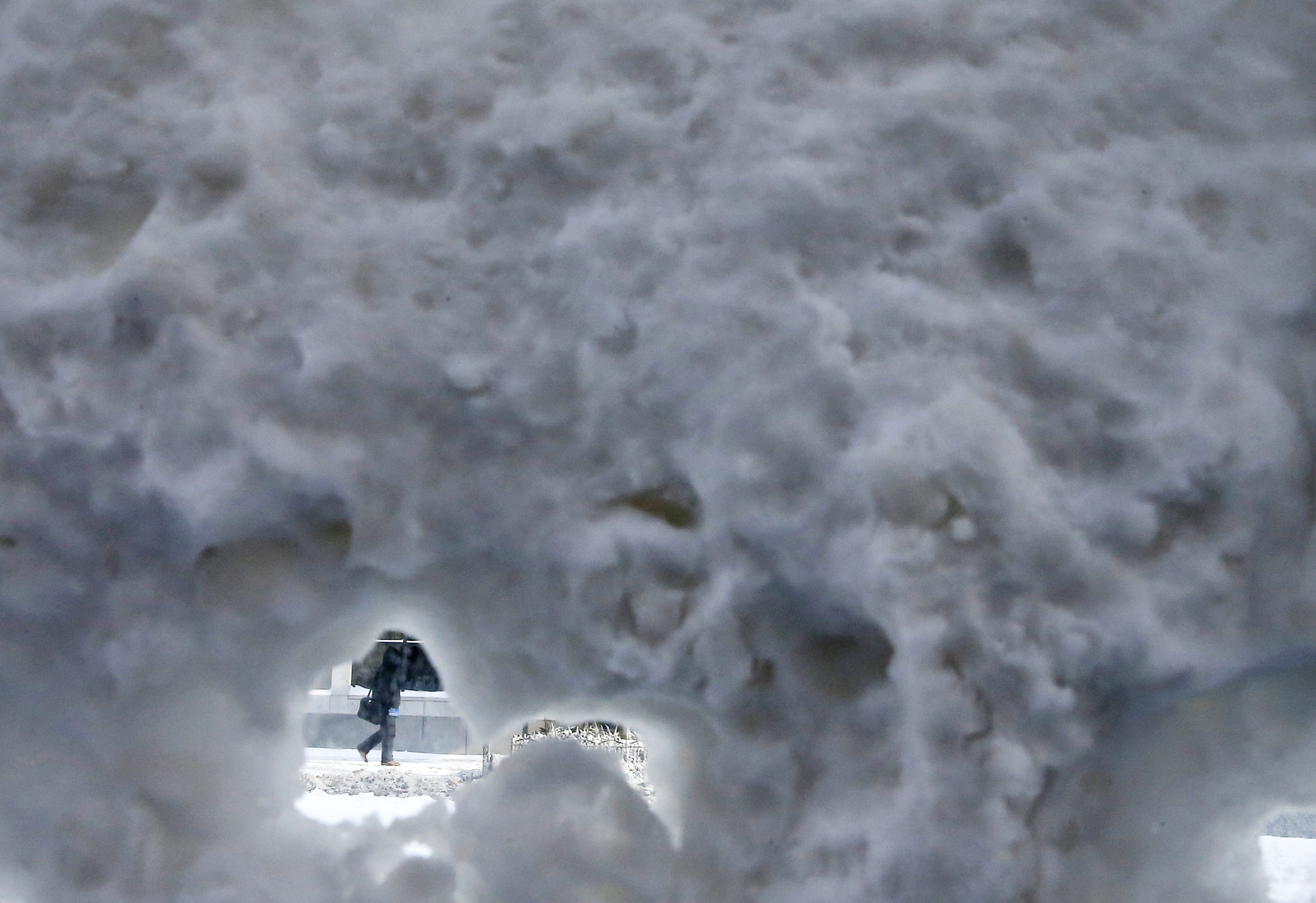 Person walking in high snow