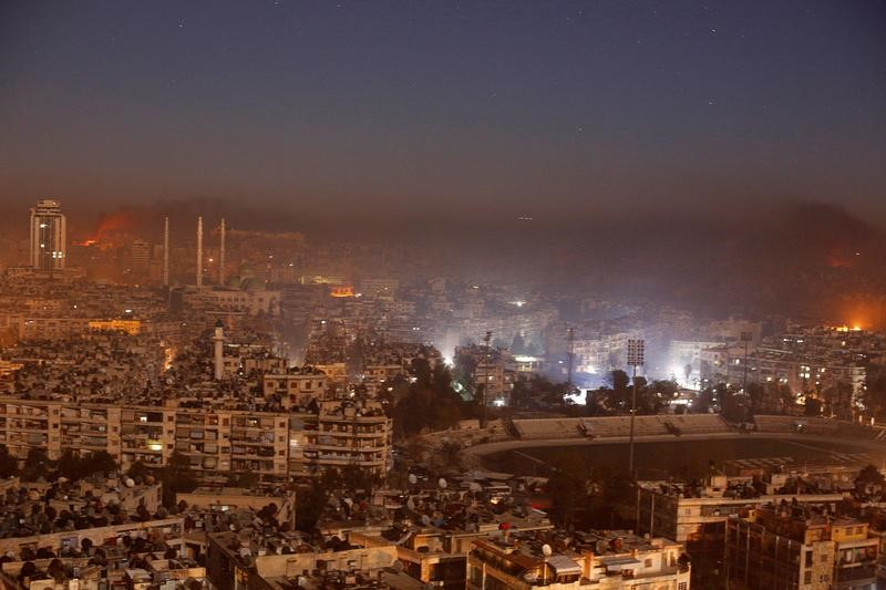 Smoke and flames rise after air strikes on rebel-controlled besieged area of Aleppo, as seen from a government-held side, in