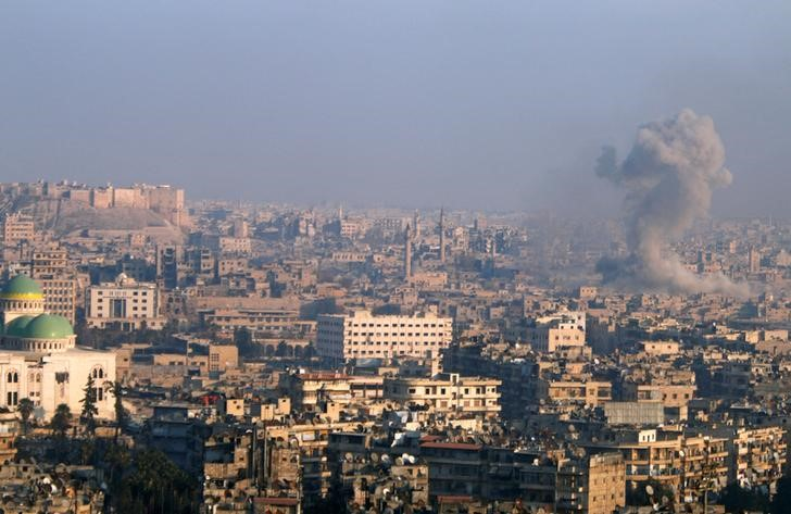 Smoke rises as seen from a government-held area of Aleppo, Syria