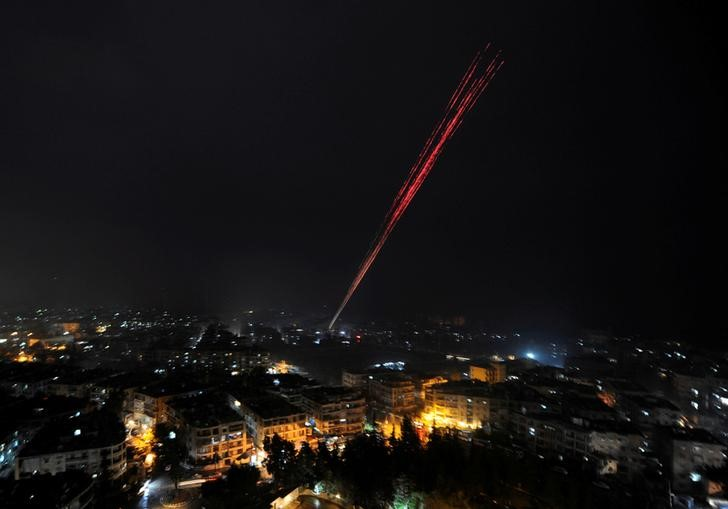 Govermental Syrian forces fire into sky as celebrating their victory against rebels in eastern Aleppo, Syria