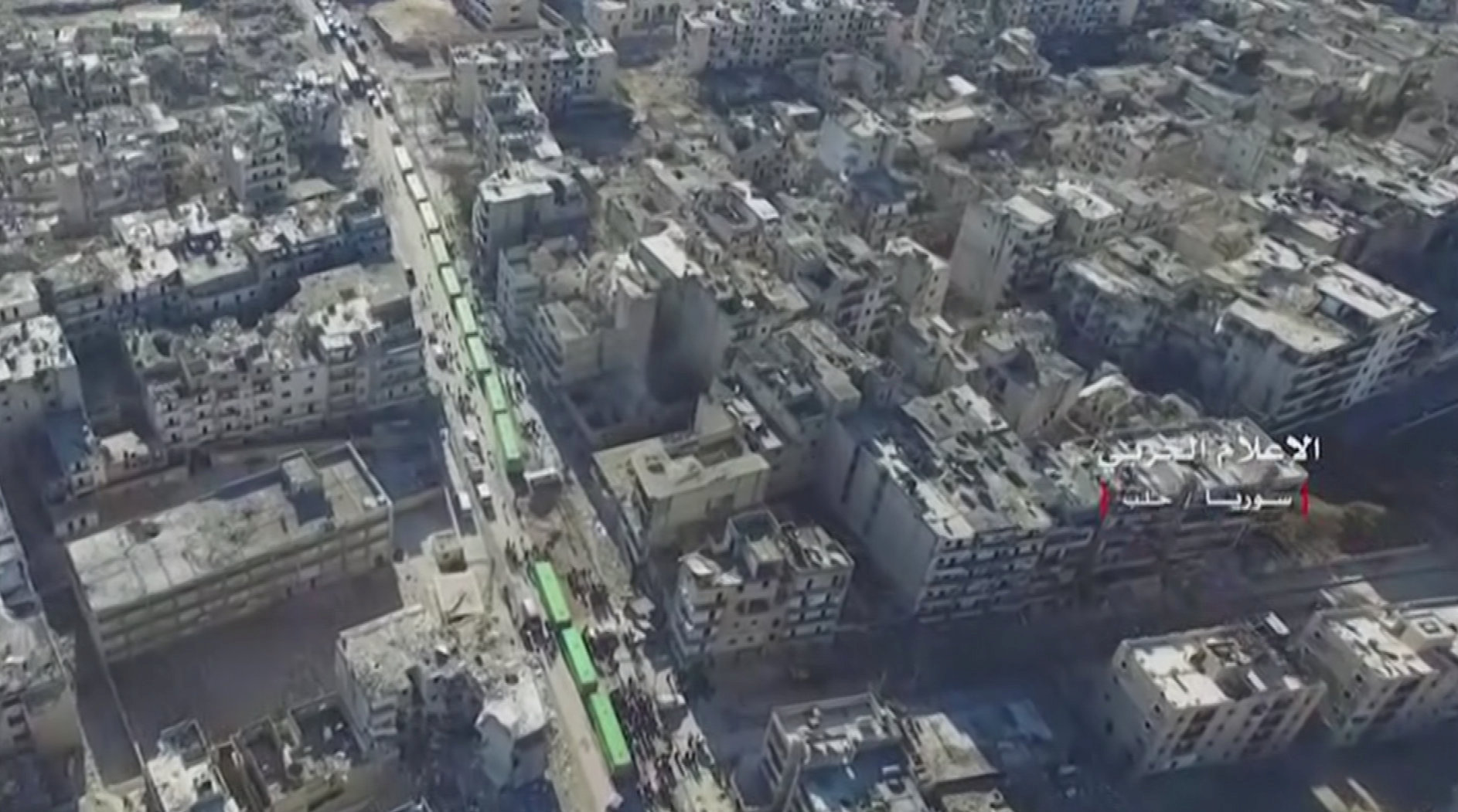 A still image from video taken December 15, 2016 over eastern Aleppo shows an operation to evacuate thousands of civilians and fighters in buses from Aleppo, Syria