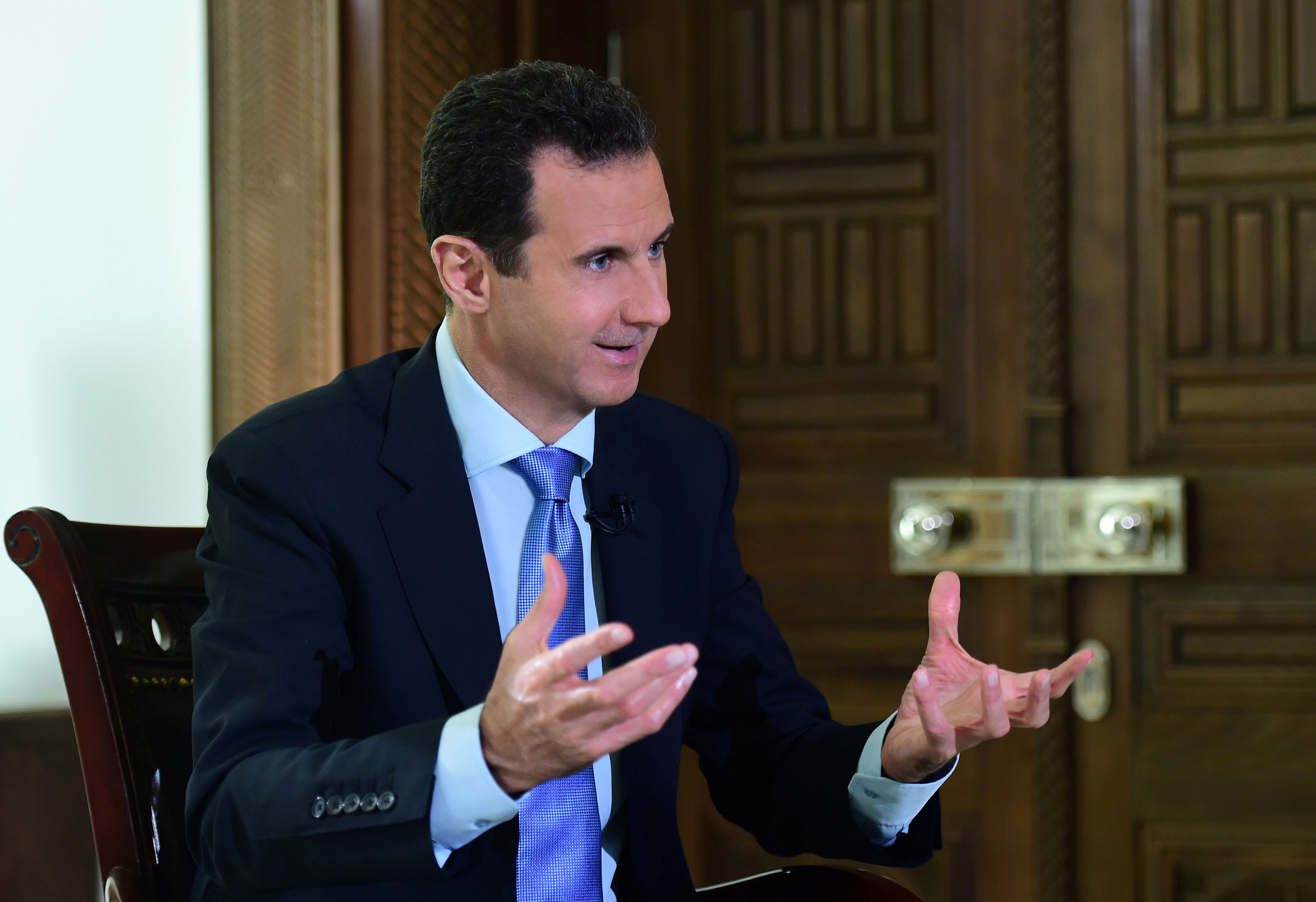 Syria's President Bashar al-Assad speaks during an interview with a Portuguese television channel