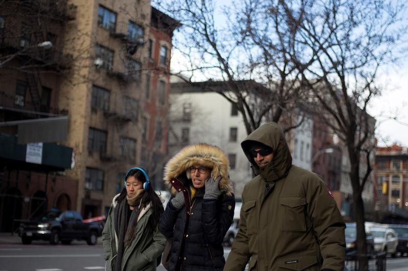People brave the cold weather in East Village in New York City, NY,