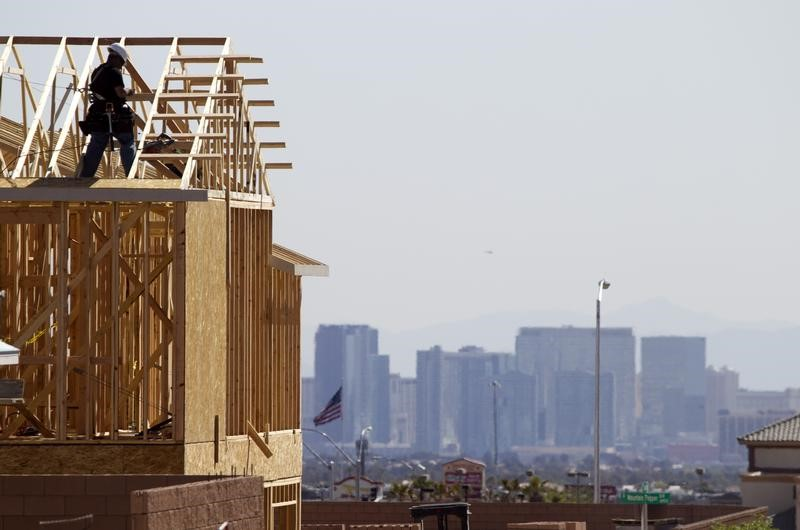 A carpenter works on a new home at a residential construction site in the west side of the Las Vegas Valley in Las Vegas