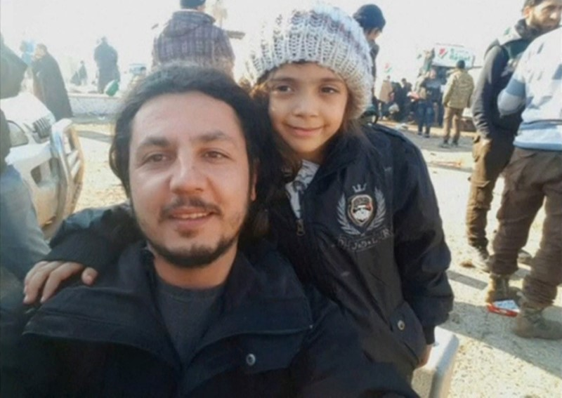 A still image taken on December 19, 2016 from a handout video posted by IHH, shows a still photograph of Syrian girl who tweeted from Aleppo, Bana Alabed, posing with IHH aid worker Burak Karacaoglu in al-Rashideen, Syria.