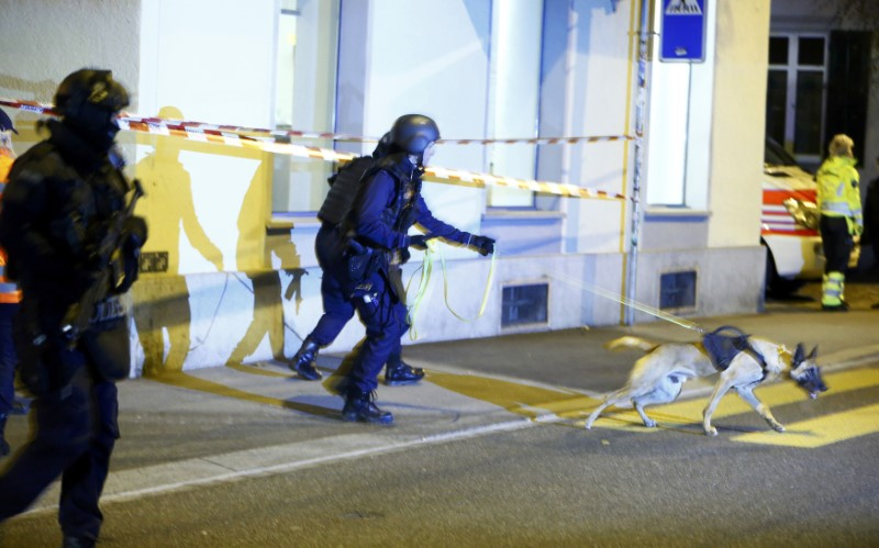 Police stand outside an Islamic center in central Zurich, Switzerland