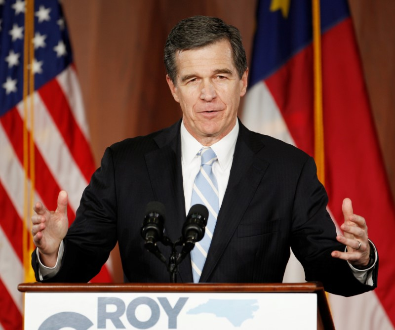 North Carolina Governor-elect Roy Cooper speaks to supporters at a victory rally the day after his Republican opponent and incumbent Pat McCrory conceded in Raleigh, North Carolina, U.S.