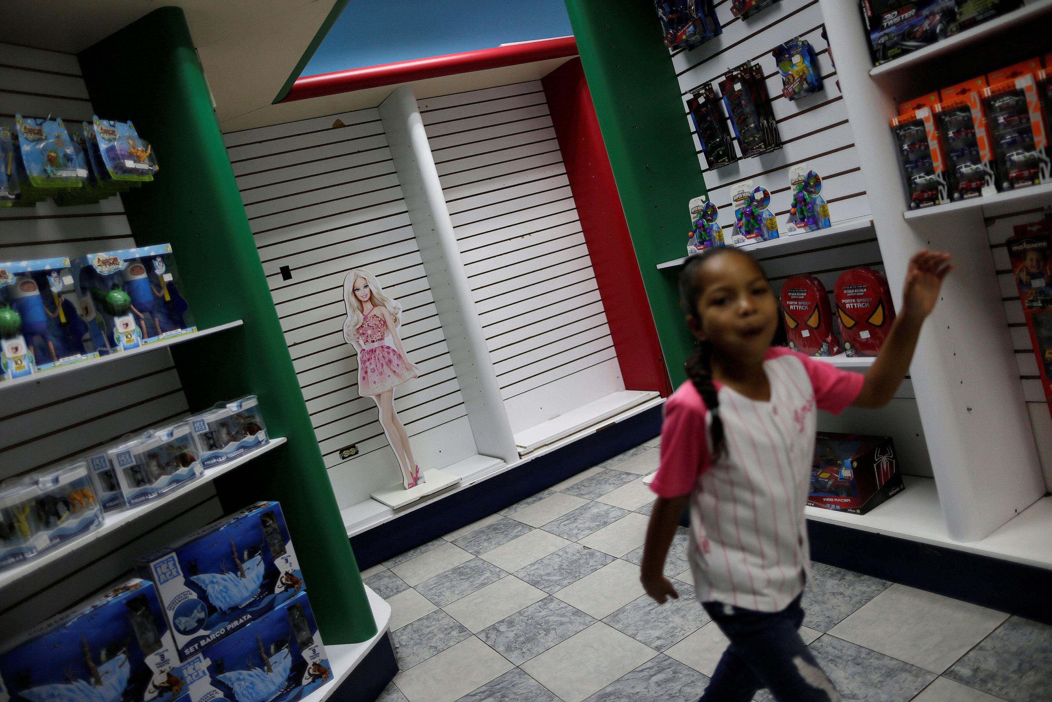 A child walks in a toy store in Caracas, Venezuela, December 1, 2016.