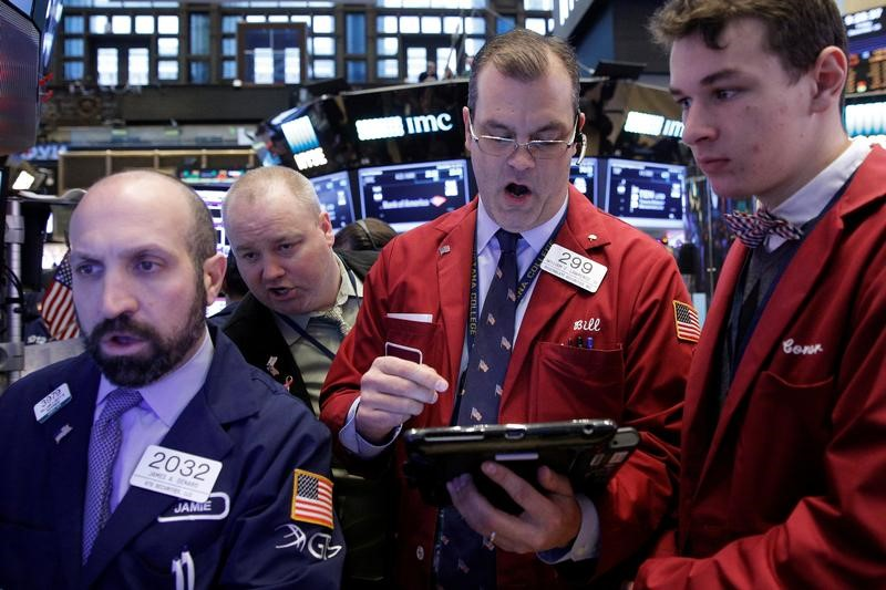 Traders work on the floor of the New York Stock Exchange (NYSE) in New York City, U.S.,