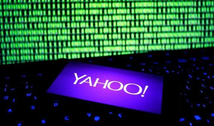 Yahoo logo near cyber screen